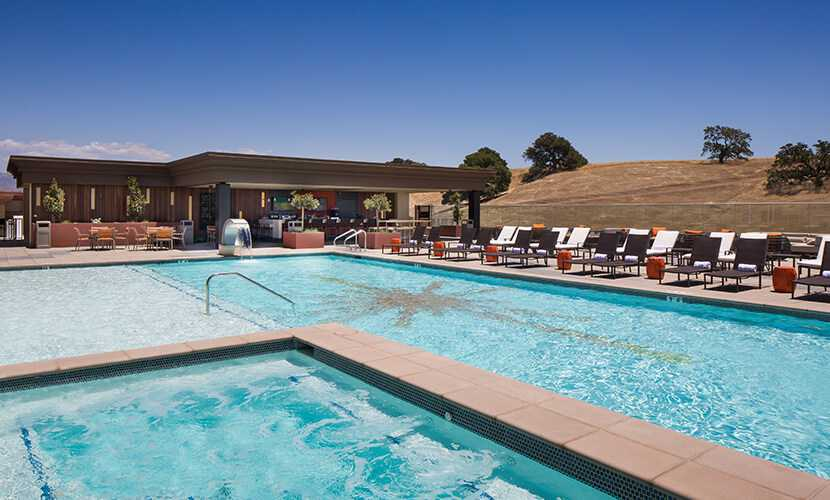 the rooftop pool is equipped with lounge chairs cabanas dining options and an outdoor ambiance that is unmatched in santa barbara county